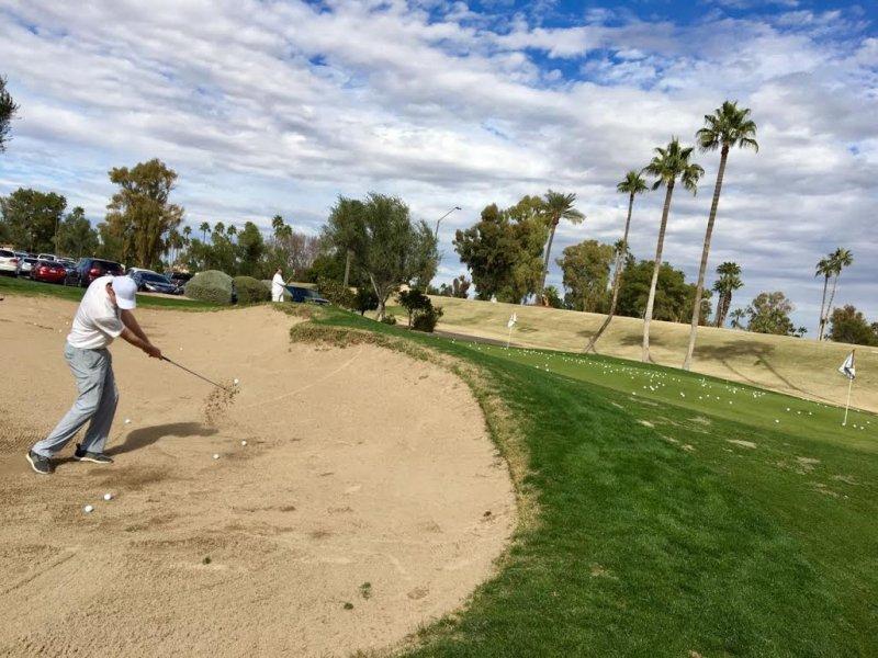 Matt bunker shot practice at McCormick Ranch Golf Club.jpg
